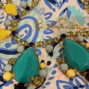 gold statement necklace with blue stones